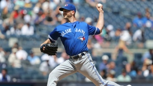 Toronto Blue Jays starting pitcher J.A. Happ throws during the first inning of the baseball game against the New York Yankees at Yankee Stadium, Wednesday, Aug. 17, 2016 in New York. (AP Photo/Seth Wenig)