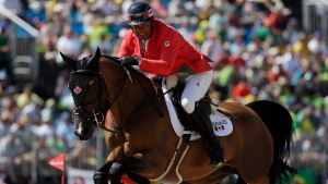 Canada's Yann Candele, riding First Choice 15, competes in the equestrian jumping competition at the 2016 Summer Olympics in Rio de Janeiro, Brazil, Wednesday, Aug. 17, 2016. (AP Photo / John Locher)