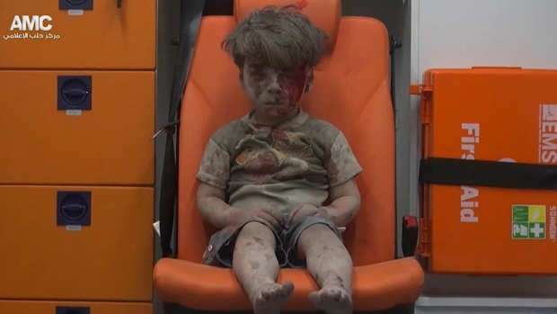 Syrian child pulled to safety after airstrike
