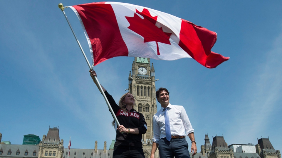 Prime Minister Justin Trudeau and Rosie MacLennan in Ottawa on July 21, 2016. (Adrian Wyld / THE CANADIAN PRESS)