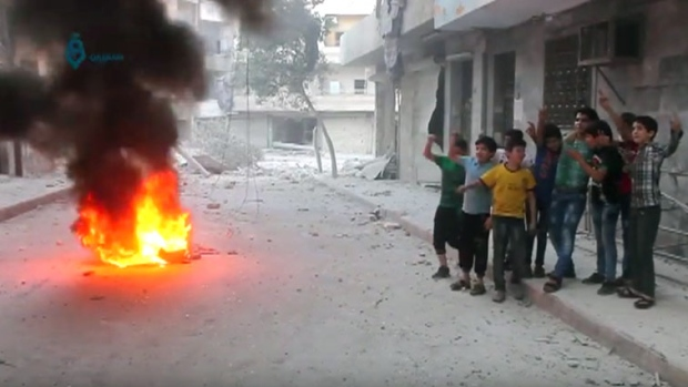 Syrian children burn tires
