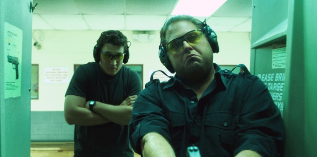 This image released by Warner Bros. Pictures shows Miles Teller, left, and Jonah Hill in a scene from 'War Dogs.'