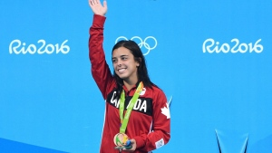Meaghan Benfeito celebrates with her bronze medal for the women's 10-metre platform diving at the 2016 Olympic Summer Games in Rio de Janeiro, Brazil on Thursday, Aug. 18, 2016. THE CANADIAN PRESS/Sean Kilpatrick