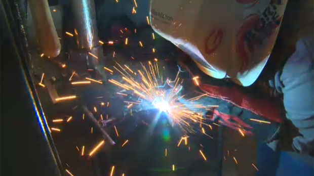 Andrea Benavides, 15, operates a torch during welding camp