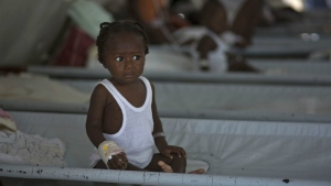 A girl receives treatment for cholera symptoms at a Doctors Without Borders, MSF, cholera clinic in Port-au-Prince, Haiti on Oct. 19, 2011. (AP / Ramon Espinosa)