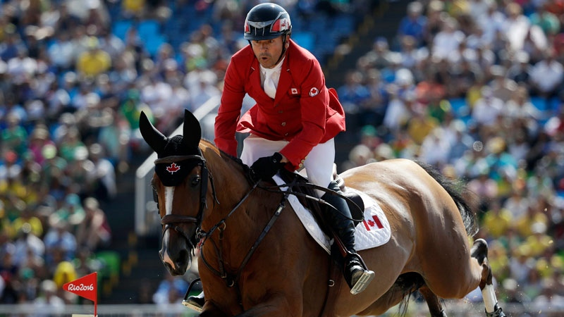 Canada's Eric Lamaze, riding Fine Lady 5, competes in the equestrian jumping competition at the 2016 Summer Olympics in Rio de Janeiro, Brazil, Tuesday, Aug. 16, 2016. (AP /John Locher)