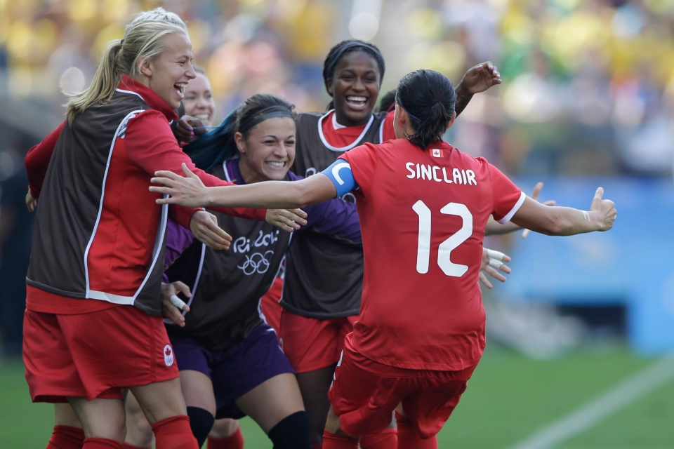 Canada's Christine Sinclair, 12, is congratulated after scoring her side's 2nd goal during the bronze medal match of the women's Olympic football tournament between Brazil and Canada at the Arena Corinthians stadium in Sao Paulo, Friday Aug. 19, 2016. (AP / Nelson Antoine)