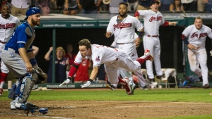 Cleveland Indians' Tyler Naquin, dives for home plate for an inside-the-park home run off Toronto Blue Jays relief pitcher Roberto Osnuo, for the game-winning run in a baseball game in Cleveland, Friday, Aug. 19, 2016. (AP / Phil Long)