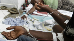 Cholera patients receive serum at the St. Nicholas Hospital in Saint Marc, Haiti on Oct. 21, 2010. (AP / Dieu Nalio Chery)
