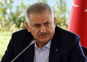 Turkish Prime Minister Binali Yildirim speaks during a meeting with foreign media representatives in Istanbul, Saturday, Aug. 20, 2016. (Prime Minister Press Service via AP)