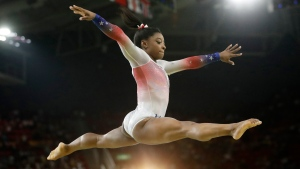 In this Aug. 17, 2016 file photo, United States' Simone Biles performs on the balance beam during the gymnastics exhibition gala at the 2016 Summer Olympics in Rio de Janeiro, Brazil. (AP Photo / Dmitri Lovetsky, File)