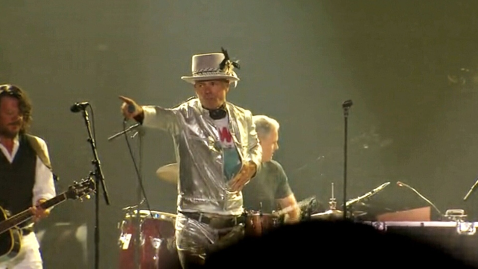 Gord Downie gestures as The Tragically Hip perform at the final concert of their 'Man Machine Poem' tour in Kingston, Ont. on Saturday, Aug. 20, 2016.