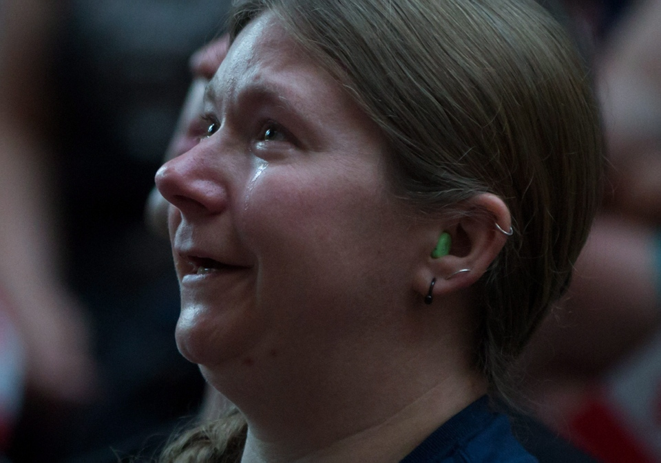 Tears run down a woman's face during a viewing party for the final stop in Kingston, Ont., of a 10-city national concert tour by The Tragically Hip, in Vancouver, B.C., on Saturday August 20, 2016. (Darryl Dyck / THE CANADIAN PRESS)