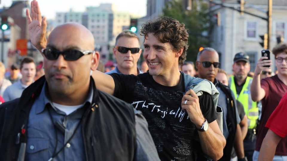 Prime Minster Justin Trudeau wears a Tragically Hip shirt on the way to Rogers K-Rock Centre in Kingston, Ont., on Saturday, August 20, 2016. (Lars Hagberg/The Canadian Press)