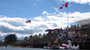Participants are shown in the Port Huron Float Down on the St. Clair River, across from Sarnia, Ont., on Aug. 21, 2016. (Benjamin Bradley-Gilbert / YouTube)