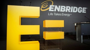 Enbridge comnay logos on display at the company's annual meeting in Calgary on Thursday, May 12, 2016. (Jeff McIntosh / THE CANADIAN PRESS)