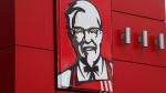 A close-up of a sign with a picture of Colonel Sanders is shown on the wall of a combination Kentucky Fried Chicken, Taco Bell in Doral, Fla., Tuesday, Oct. 9, 2012. (AP / Wilfredo Lee)