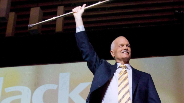 NDP Leader Jack Layton raises his cane as he takes to the stage in Vancouver, B.C., on June 19, 2011. He died almost two years ago, but every day in British Columbia's election campaign Jack Layton seems to make some kind of appearance, whether it be in a stump speech, a ghost-like moment or a question, reflection or thought from a voter.THE CANADIAN PRESS/Darryl Dyck