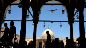 Worshippers leave Friday prayers at Amr Ibn al-As mosque, in Cairo, Egypt, Friday, July 15, 2016. (AP Photo/Amr Nabil)
