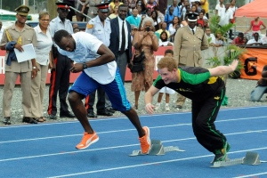 Britain's Prince Harry, right, and Olympic sprint champion Usain Bolt run during a mock race in Kingston, Jamaica, Tuesday March 6, 2012. (AP / Collin Reid)