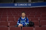 Syrian refugee Shergo Kurdi, 15, watches St. Louis Blues NHL hockey practice after a tour of Rogers Arena in Vancouver, B.C., on Saturday March 19, 2016. (THE CANADIAN PRESS/Darryl Dyck)
