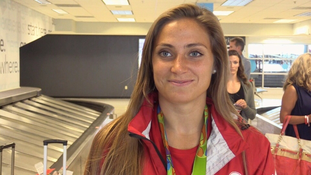 Shelina Zadorsky, a member of Canada's Olympic bronze medal-winning women's soccer team arrives at the London International Airport on Tuesday, August 23, 2016.