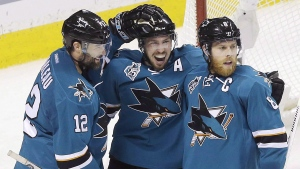 San Jose Sharks center Logan Couture, center, celebrates after scoring a goal with Patrick Marleau (12) and Joe Pavelski (8) during the third period in Game 6 of the NHL hockey Stanley Cup Western Conference finals against the St. Louis Blues in San Jose, Calif., Wednesday, May 25, 2016. (THE CANADIAN PRESS/ AP- Jeff Chiu)