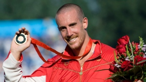 Canada's Thomas Hall of Pointe-Claire, Que. celebrates his bronze medal win in the canoe single (C1) 1000 meter final at the Beijing Olympics in Beijing, China, Friday, Aug. 22, 2008. (THE CANADIAN PRESS/Jonathan Hayward)