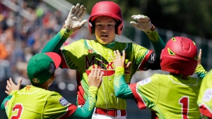 Mexico's Jose Angel Leal, center, celebrates with teammates after hitting a two-run home run off Canada's Stefano Dal Sasso during the third inning of an International elimination baseball game at the Little League World Series tournament in South Williamsport, Pa., Tuesday, Aug. 23, 2016. (Gene J. Puskar/AP Photo)
