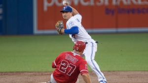 Los Angeles Angels' Mike Trout is forced out at second base as Toronto Blue Jays' Darwin Barney throws to first base to complete the double play on a ball hit by Angels' Albert Pujols during third inning Major League baseball action in Toronto on Tuesday, August 23, 2016. (Chris Young/The Canadian Press)