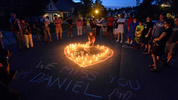 Friends and family of Daniel Harris gather around a heart drawn onto Seven Oaks Drive during a candlelight vigil to remember Harris, a deaf motorist who was shot and killed by a state trooper, Monday, Aug. 22, 2016 in Charlotte, N.C. (David T. Foster III/The Charlotte Observer via AP)
