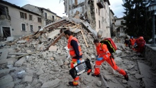 Rescuers in central Italy after 6.1 earthquake