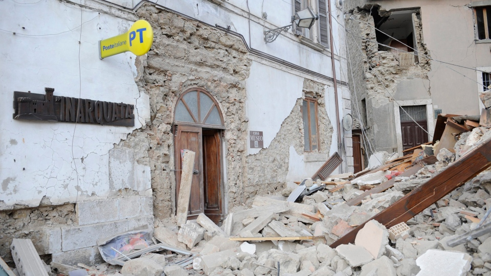 A post office is engulfed by rubbles in Arcuata del Tronto, central Italy, where a 6.1 earthquake struck just after 3:30 a.m., Wednesday, Aug. 24, 2016. (AP / Sandro Perozzi)