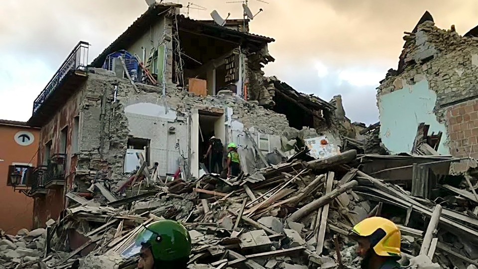 This still image taken from video shows rescuers searching a collapsed building in Amatrice, central Italy, where a 6.1 earthquake struck just after 3:30 a.m., Wednesday, Aug. 24, 2016. (AP)