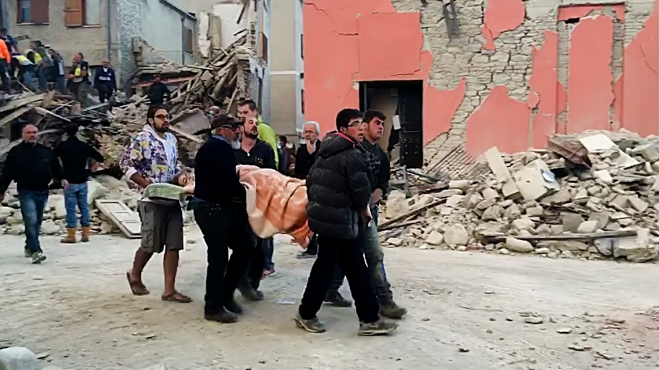 This still image taken from video shows rescuers recover a victim from a crumbled building in Amatrice, central Italy, where a 6.1 earthquake struck just after 3:30 a.m., Wednesday, Aug. 24, 2016. (AP)