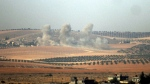 Smokes billows near the Turkey-Syria border on Wednesday, Aug. 24, 2016. (DHA via AP)