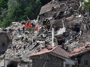 A man is rescued from the rubble of a building after an earthquake, in Accumoli, central Italy, Wednesday, Aug. 24, 2016. (AP Photo/Andrew Medichini)