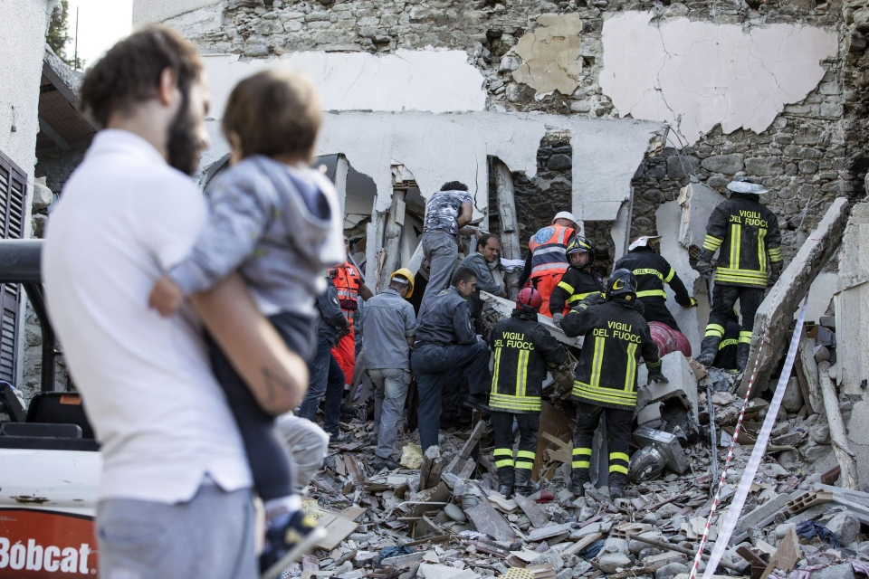 Firefighters search amid rubble following an earthquake in Accumoli, central Italy, Wednesday, Aug. 24, 2016. (Angelo Carconi/ANSA)
