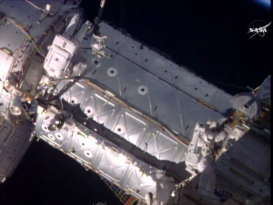 This image provided by NASA shows American astronauts Jeffrey Williams, left, and Kate Rubins taking a spacewalk to hook up a docking port outside the International Space Station on Friday, Aug. 19, 2016. (NASA via AP)