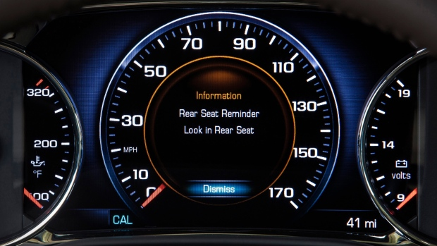 This photo provided by General Motors Co. shows an industry-first Rear Seat Reminder alert on the instrument panel of the 2017 GMC Acadia, a midsize SUV. (A.J. Mueller/General Motors Co. via AP)