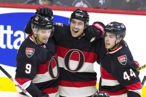 In this November 5, 2015 file photo, Ottawa Senators' Cody Ceci (centre) celebrates his goal wth teammates Jean-Gabriel Pageau (44) and Milan Michalek (9) during first period NHL hockey against the Winnipeg Jets in Ottawa. (Fred Chartrand / THE CANADIAN PRESS)