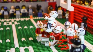 This undated image taken from video provided by Lego animator Jared Jacobs shows a frame from a video he created of BYU's Mitch Mathews catching a 42-yard pass by BYU quarterback Tanner Mangum with no time left to beat Nebraska 33-28 in Lincoln, Neb., last September. It took 30 hours to make the frame-by-frame video. (Jared Jacobs via AP)