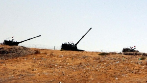 Turkish artillery stationed near the Syrian border in Karkamis, Turkey, Wednesday, Aug. 24, 2016. (AP Photo)