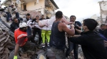 A rescued woman is carried away on a stretcher following an earthquake in Amatrice Italy, Wednesday, Aug. 24, 2016. (Massimo Percossi / ANSA via AP)