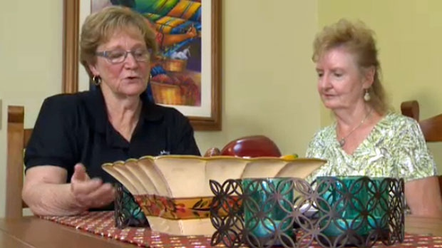 Jan Townsend (left) and Bonnie Nelson review some of the books provided to Mayans through the Heart & Hands Foundation