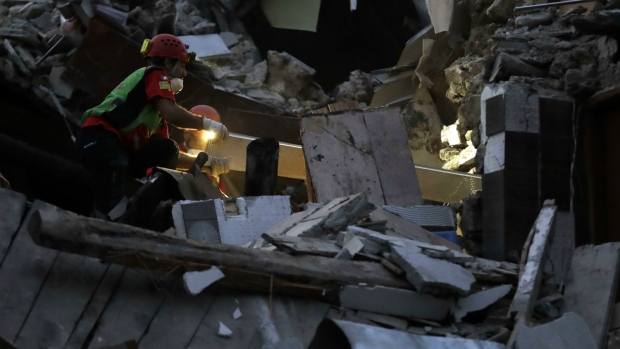 Rescuers search through debris following an earthquake in Pescara Del Tronto, Italy on Wednesday, Aug. 24, 2016. (AP / Andrew Medichini)