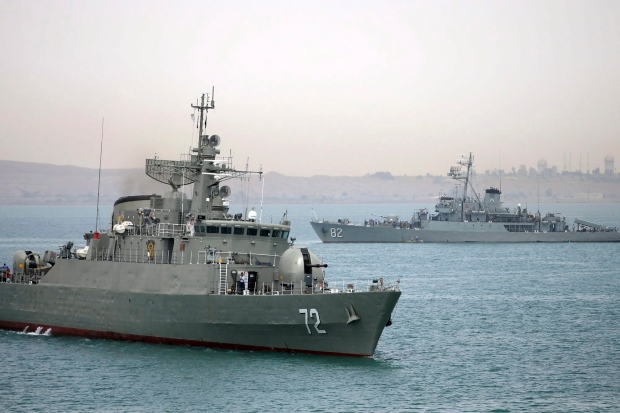 In this picture taken on Tuesday, April 7, 2015, and released by the semi-official Fars News Agency, Iranian warship Alborz, foreground, prepares before leaving Iran's waters. (AP / Fars News Agency, Mahdi Marizad)