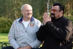 In this photo taken Wednesday, Aug. 24, 2016, Belarusian President Alexander Lukashenko, left, meets with Hollywood actor and producer Steven Seagal in the presidential residence of Drozdy, outside Minsk, Belarus. (Andrei Stasevich / Pool via AP)