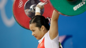 In this Aug. 9, 2008, file photo, China's Chen Xiexia holds up 90kg in the snatch of the women's 48kg category of the weightlifting competition at the Beijing 2008 Olympics in Beijing, China.