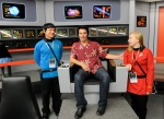In this Saturday, Aug. 13, 2016 photo, Keith Schubert of Peru, N.Y., left, dressed as Star Trek's Mr. Spock, and his daughter Tiffany Schubert, right, talk with James Cawley, center, during a tour of his replica of the starship Enterprise from the original 'Star Trek' series during the Trekonderoga festival in Ticonderoga, N.Y. (AP Photo/Hans Pennink)